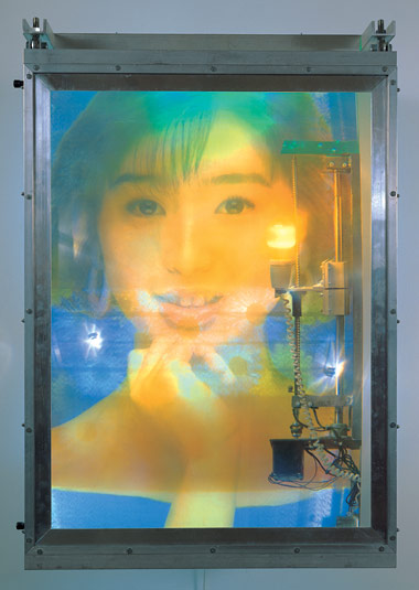 Jon Kessler, Noriko, 1994. Plexiglas, aluminum, screenprint on cloth, duratran, mixed media with lights and motors, 47 x 31 x 26 inches